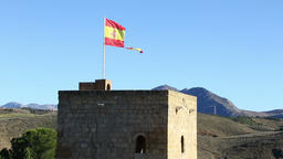 Torn Spanish flag waving on the wind Footage