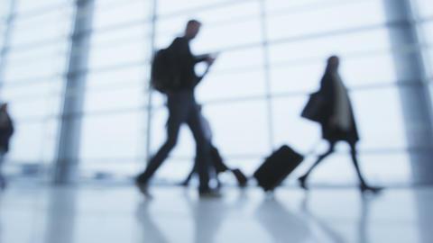 People walking in airport terminal Footage
