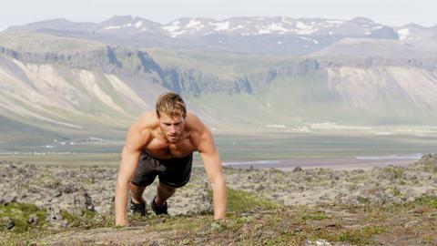 Pushups fitness man doing push-ups outside nature Footage