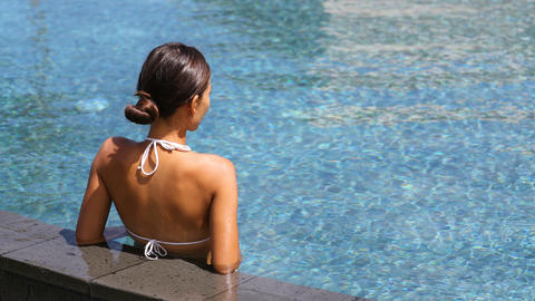 Swimming pool resort relaxation relaxing woman enjoying travel Footage