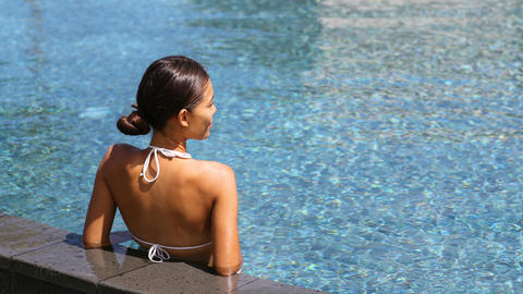 Travel luxury wellness spa retreat woman relaxing in swimming pool Footage