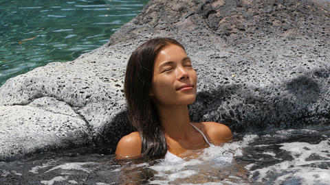 Jacuzzi at resort Spa wellness - woman relaxing in hot tub whirlpool pool Footage