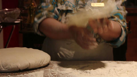 Woman kneading dough and baking bread Footage
