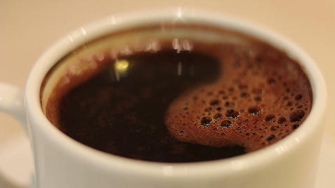 White cup of coffee rotating and flashing Footage