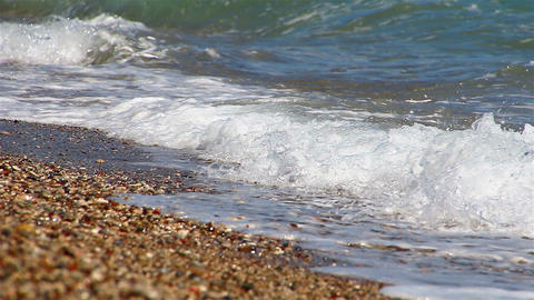 Background of waves of the sea on the beautiful pebble beach Footage