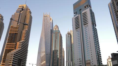 Mirror facade on skyscrapers in Dubai City in UAE on sky background 画像