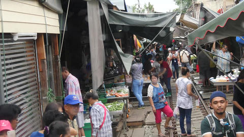 (Timelapse) View of Mae Klong railway market from the Mae Klong line train Footage