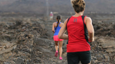 Trail running race - man runner running away close up slow motion Footage