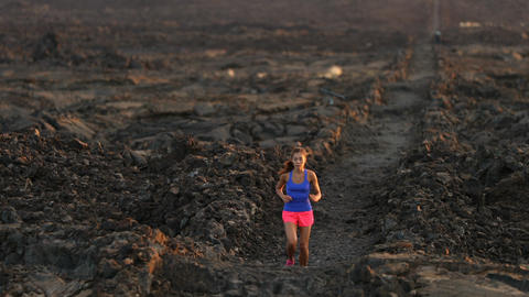 Running runner woman trail running cross country running on volcano Footage