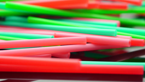 A pile of color juice straws Live Action