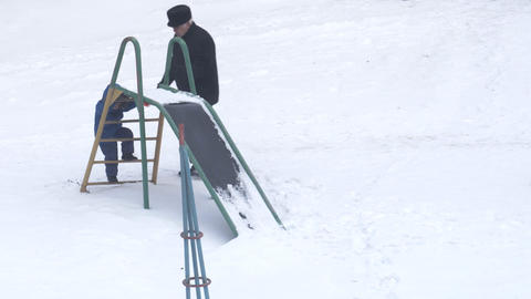 Grandfather and his grandson walk in winter Footage