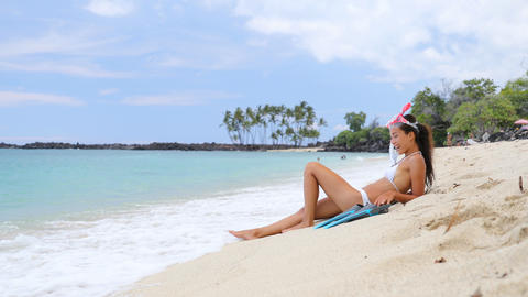 Woman relaxing on beach vacation wearing snorkel with mask and fins, beach life Footage