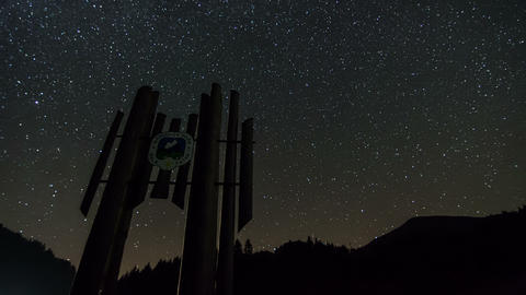 Stars rotate over national park symbol silhouette time lapse. Dolly shot Footage