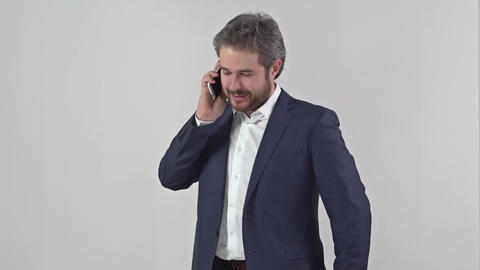 Businessman in suit talking on a mobile phone Footage