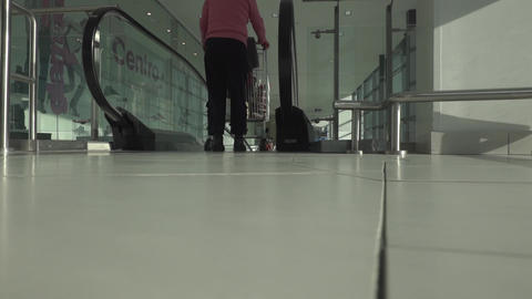 Woman go with shopping cart to the escalator Footage