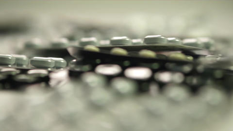 Isolated drugs in blister packs shallow focus dolly shot Footage