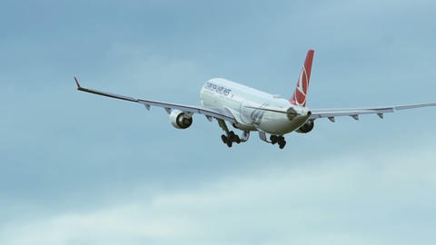 Airbus A330 of Turkish airlines is flying away after takeoff Footage