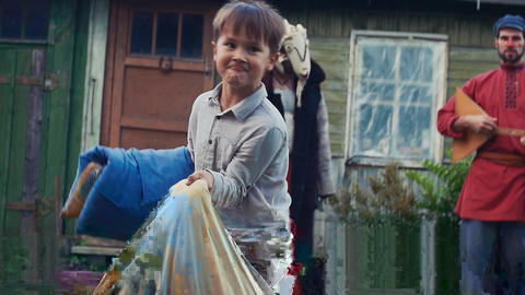 Kids fight pillows in yard country house. Childhood. Men in costumes. Balalaika Footage