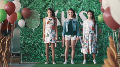 Teenage girls models hand movement on podium at kids fashion show Live Action