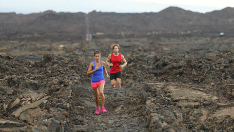 Runners - Determined Athletic Couple Running In Arid Landscape Footage