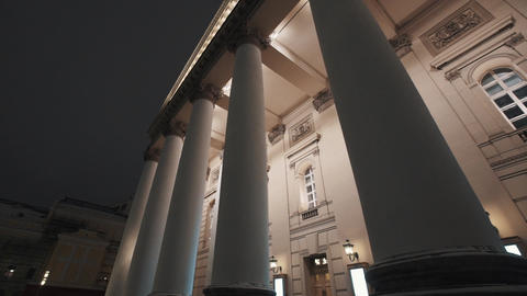 Facade of Bolshoi Theatre building, lighted up columns on winter night Footage