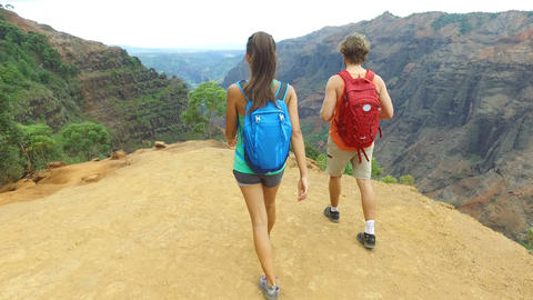 Couple hiking on Waimea Canyon hike Kauai Hawaii Live Action