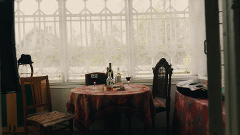 View of table with alcohol drinks on terrace of country house. Summer day Footage