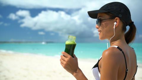 Woman Drinking Green Vegetable Smoothie On Beach - Healthy Diet Detox Juice Footage