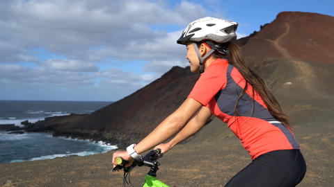 Mountain biking MTB cyclist woman cycling on mountain bike trail Footage