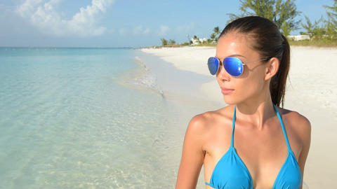 Beach bikini Asian woman wearing fashion sunglasses eye wear Footage