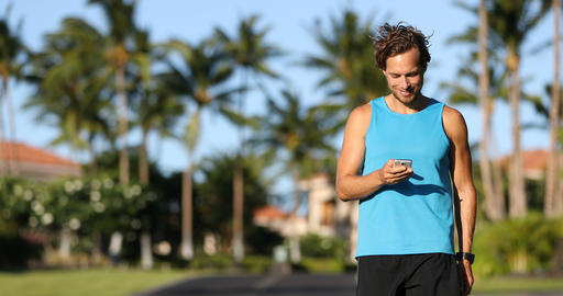 Fitness man looking at smart phone fitness app after running Footage