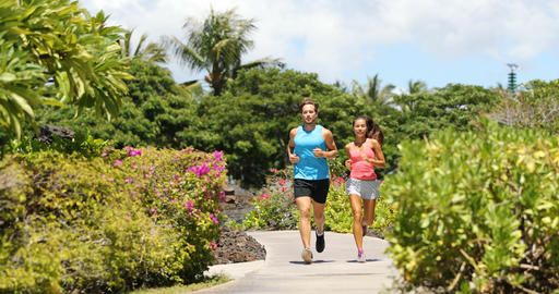 Sport runners running on summer park trail Footage