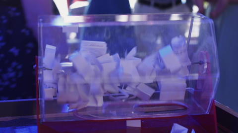 Woman rotate lottery transparent box in restaurant.... Stock Video Footage