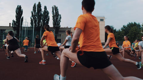 MOSCOW, RUSSIA - JUNE 20, 2016: Sportive people group doing exercises strething Footage