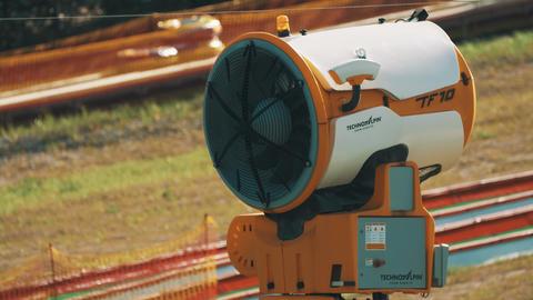 Large turbine slowly turning at outdoors park with tube and fencing on back ライブ動画