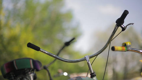 Two handlebars focus in, in summer sunny evening. Pan horizontal Footage