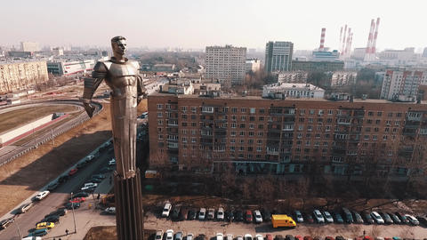 Drone flight around Yuri Gagarin monument on road rush traffic crossroad in city Footage