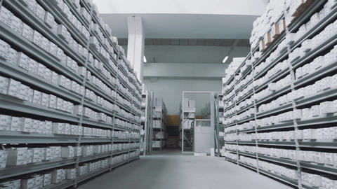Bright repository shelves full of white boxes with numbers markings Footage