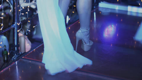 Sexy go go girl in white bikini dance on party in nightclub. High heels. Make up Footage