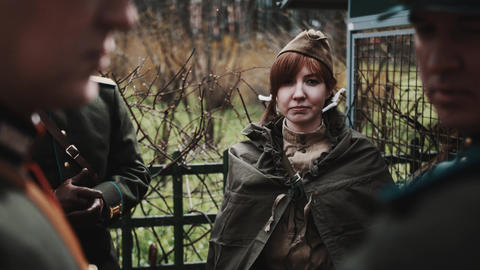 Red haired girl in group of men in retro soviet officer uniforms Footage