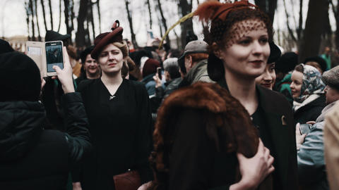 Women in retro costumes walking trought corridor of people crowd Footage