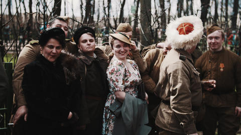 Group of men in wwii soviet soldiers costumes and women in vinta Footage
