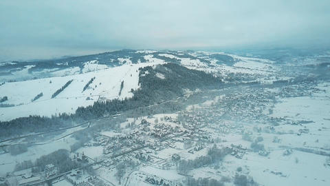 Aerial view of Bialka Tatrzanska village, the famous ski resort on a hazy winter Footage