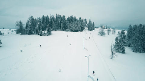 Aerial view of a snowy ski resort in winter Footage