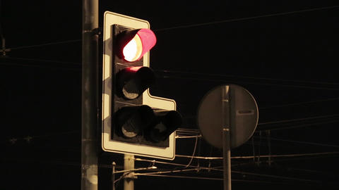 Traffic light switch colors. Red, yellow, green. Night city. Nobody. Close up Footage