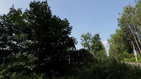 View of countryside with green trees and mansion. Summer. Pan horizontal. Nobody Footage