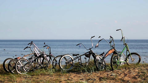 Bicycles stay on hill calm sea on background. Summer sunny day. Nobody no people Live Action