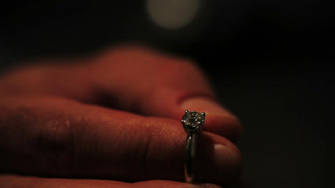 Man hold engagement ring with diamond. Proposal. Romantic moment Live Action