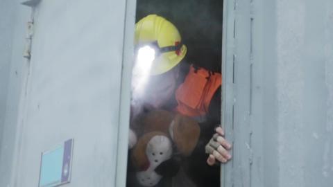 SAINT PETERSBURG, RUSSIA - NOVEMBER 28, 2015: Men with toy in helmet, rescue Footage