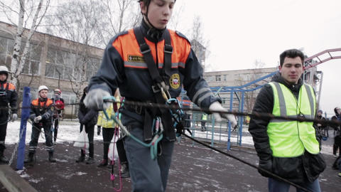 SAINT PETERSBURG, RUSSIA - NOVEMBER 28, 2015: Boy in helmet, rescue equipment Footage